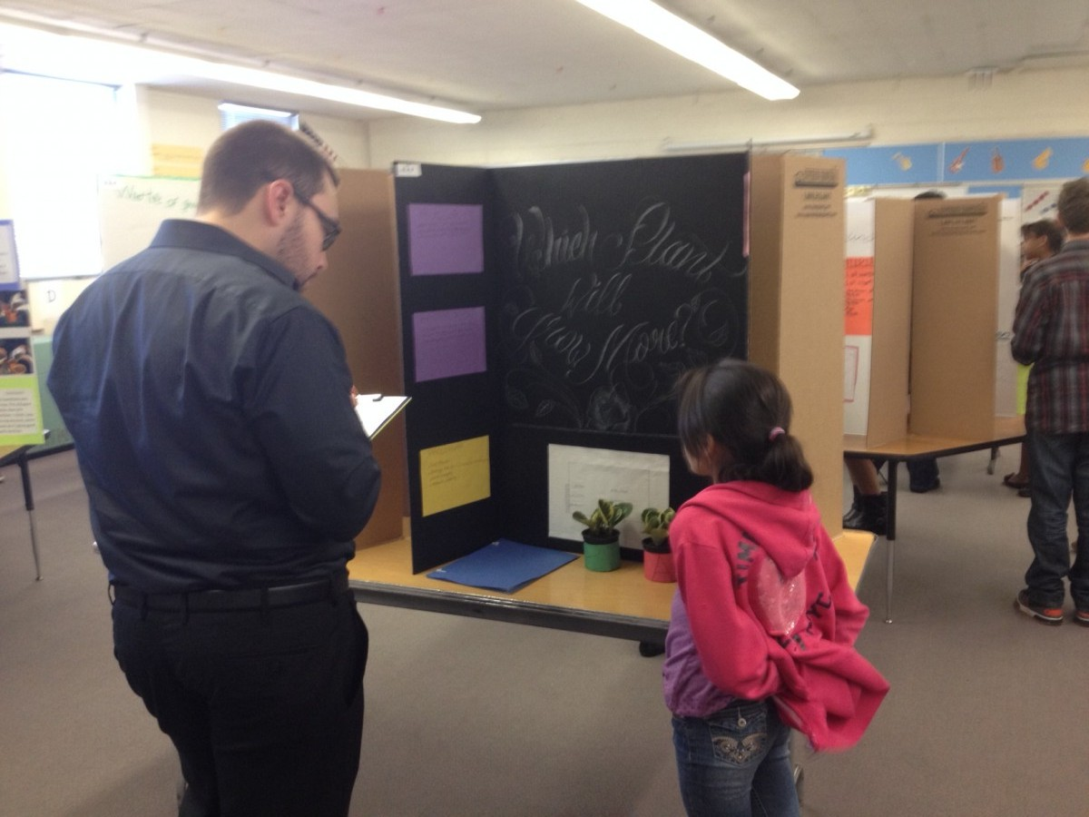 Employee supporting 5th Grade Science Fair at Will Rogers Elementary in Colorado Springs, Colorado.