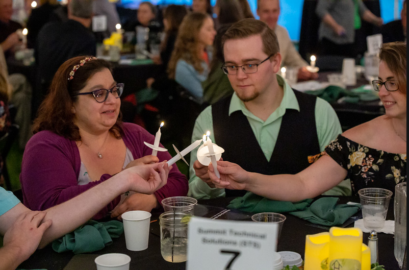 STS Sponsored the Dinner in the Dark Event - Lighting vigil candles